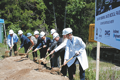 Beaufort Memorial Hospital CEO Russell Baxley, center, leads the groundbreaking KEVIN AYLMER