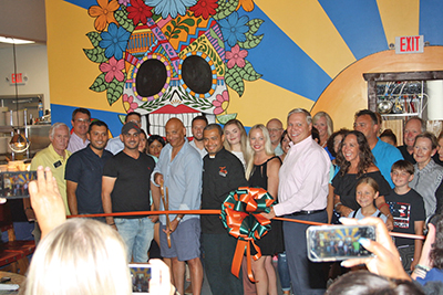 Tio's Latin American Kitchen held its grand opening and ribbon cutting June 19 at its new location in Shelter Cove Towne Centre. LYNNE COPE HUMMELL
