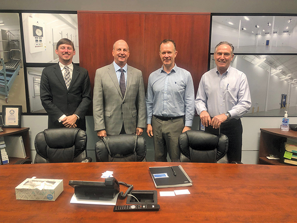 From left, Norris Thigpen of the S.C. Department of Commerce, Bruce Ward of SmartScan met with Jeff Mumford and Glen McCarthy of Labworks International in Canada.