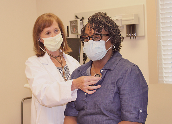 Dr. Rhonda Wallace gives a patient a preliminary exam at Beaufort Memorial Bluffton Primary Care. LYNNE COPE HUMMELL