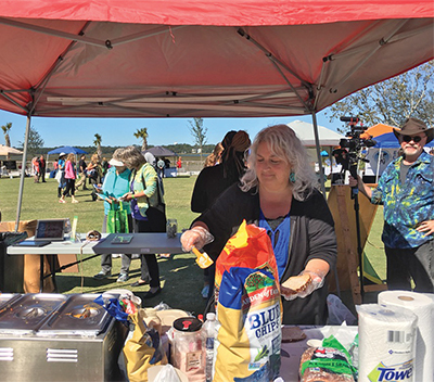 Tracy Owens of Pure Natural Market on Hilton Head Island serves up some tasty vegan treats at a previous year's VegFest at Shelter Cove Community Park. LYNNE COPE HUMMELL