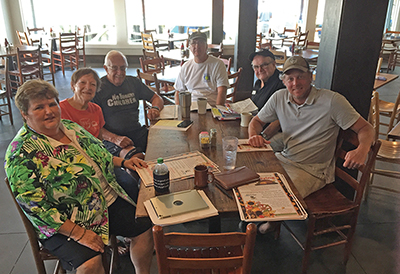 The planning committee for the annual Community Thanksgiving Dinner met at Hudson's Oct. 7 to begin work for this year's event, scheduled for Thanksgiving Day, Nov. 28. From left are Gloria LaCoe, C.J. Humphrey, Dave Bisbee, Bill McCormack, Allan LaCoe an