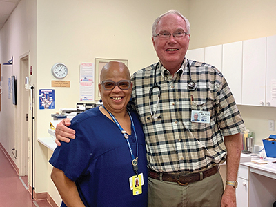 Gigi Sharper-Moore, now a nurse's assistant at VIM, and Dr. Rick Sunderlin, an endocrinologist who has worked at the clinic for 20 years. He has treated Gigi for her diabetes. COURTESY VOLUNTEERS IN MEDICINE