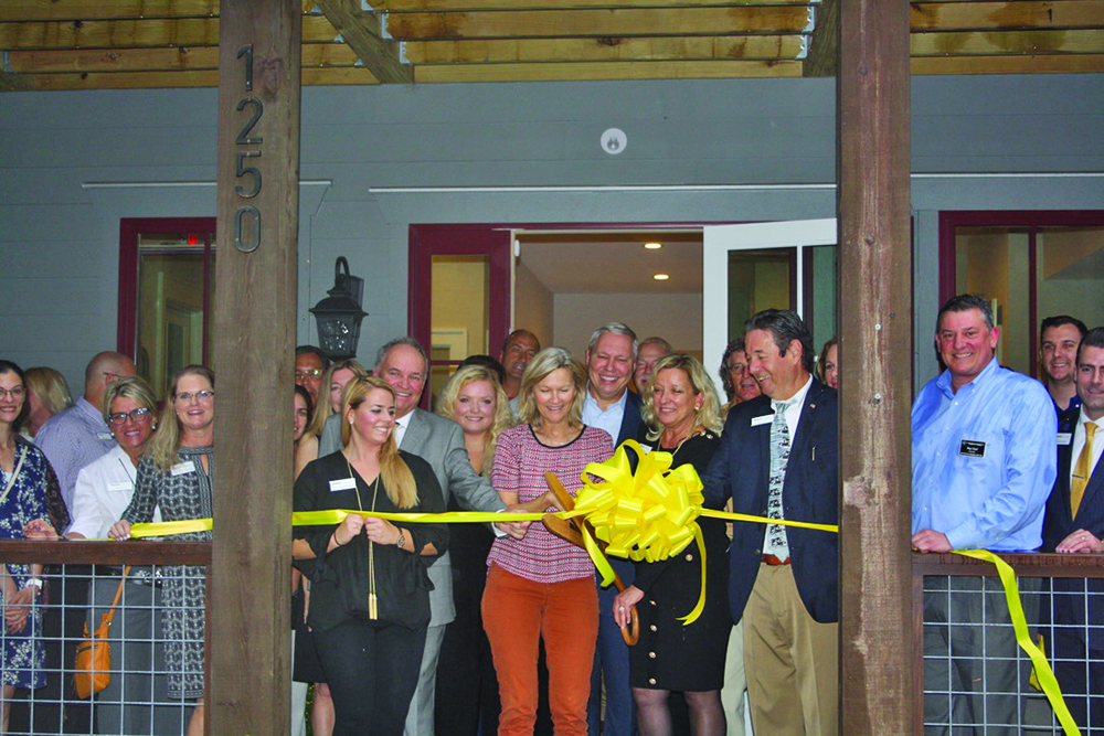 Karen and Joe Ryan, owners and brokers in charge of Weichert Realtors Coastal Properties, cut the ribbon Oct. 29 on their new building, at 1250 May River Road, with the help of Bluffton Mayor Lisa Sulka. KEVIN AYLMER
