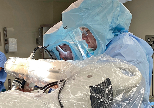 Beaufort Memorial orthopaedic surgeon  Dr. Edward Blocker performs the hospital's first robot-assisted knee replacement surgery late last month. COURTESY BEAUFORT MEMORIAL HOSPITAL