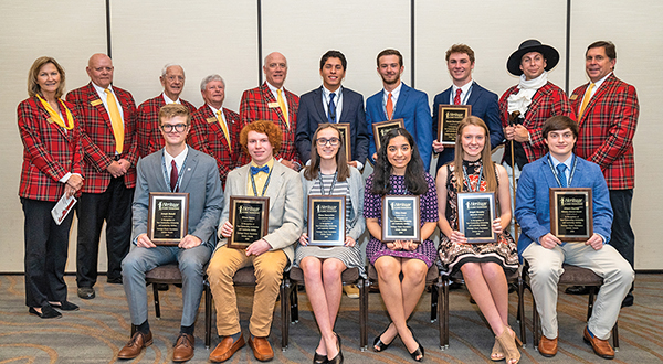 Nine of the 10 newly named Heritage Classic Foundation Scholars from Beaufort and Jasper counties pose with members of the Heritage Classic Foundation Scholar Committee Jan. 28. COURTESY HERITAGE CLASSIC FOUNDATION