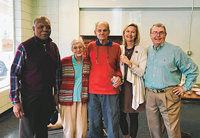 Celebrating the legacy of the McCracken family and Stock Farm Antiques on Jan. 23 were, from left, longtime friend Jacob Martin, Teddy McCracken, Emmett McCracken, current Bluffton Mayor Lisa Sulka, and former Mayor Hank Johnston. The McCrackens have reti
