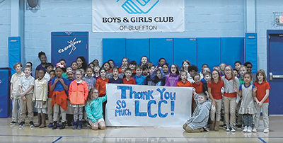 Members of the Boys & Girls Club of Bluffton post with a