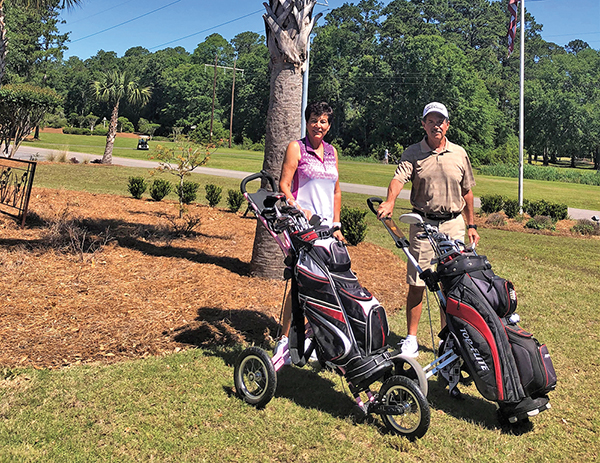 Steve and Diane Hessler get ready to walk a round at Rose Hill Golf Club. JEAN HARRIS