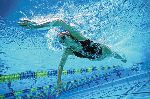 Try swimming with your fists to help 'feel' the water