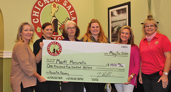 Ower Kelly Paslawski and managers at Chicken Salad Chick in Bluffton presented a donation check to their co-worker Marti Marcurella, third from left, May 26 at the store. Marcurella lost her home in a fire May 13.  KEVIN AYLMER
