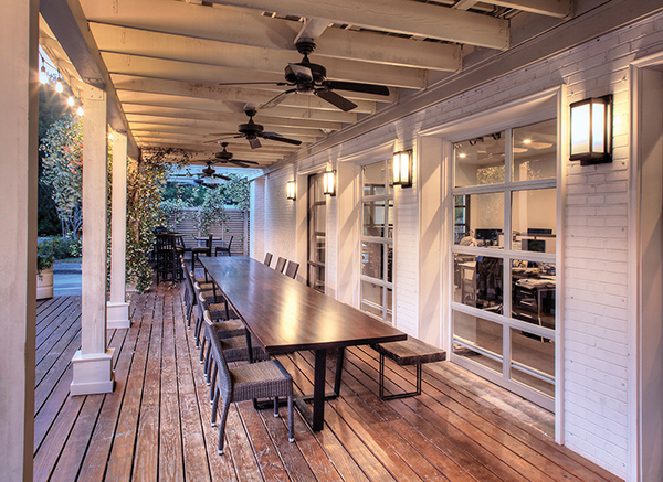 With a completely renovated interior, the new Court Atkins group headquarters on Bruin Road features an outdoor conference table, which was created from the bar at the former Red Fish restaurant, the previous occupant of the space. PHOTOS COURTESY COURT A
