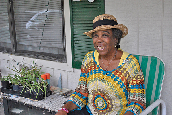 Anne Cooke on the porch at her home in Bluffton. GWYNETH J. SAUNDERS