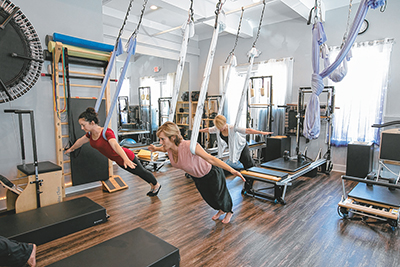 The soon-to-open Dancing Hammock Pilates and Movement center offers a variety of fitness options, including suspension techniques in flowing silk hammocks. JACQUELINE FRIEL