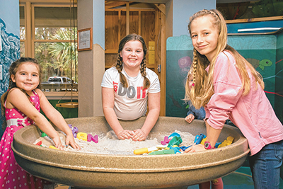 Young visitors enjoy playing in the sand pit at the Sandbox Children's Museum on Hilton Head Island. The museum will soon open a second location in Bluffton at Tanger 2 Outlet. COURTESY SANDBOX CHILDREN'S MUSEUM