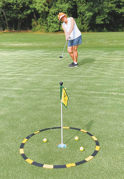 Cody Jennings practices lag putting by trying to putt into a 3-foot radius circle. JEAN HARRIS