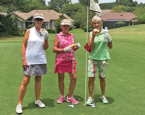Enjoying snacks on the golf course are Jane Olthuis, Ellen Hart and Dr. Jean Harris. DEBBY GREEN