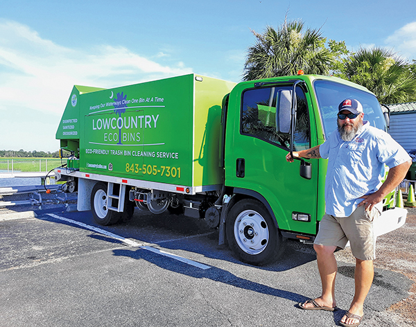 Lowcountry Eco Bins owner Kirk Parker, better known as Parker, poses July 8 in front of his truck, which is outfitted with equipment to clean trash bins. AMY COYNE BREDESON