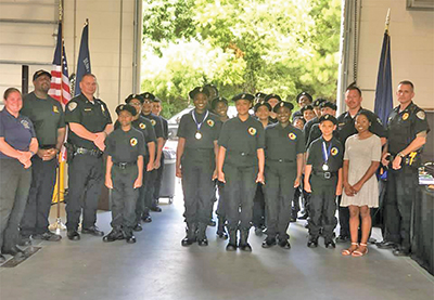 Graduates of the Bluffton Explorers Learning for Life Program pose with Bluffton Police Chief Chris Chapmond at graduation ceremonies June 28 at BPD. COURTESY BLUFFTON POLICE DEPARTMENT