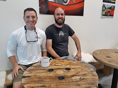 Rob Harman, left, created tables at The Grind Coffee Roasters for his friend Ian Duncan, right. Some of the markings on the tables are made with coffee grounds and epoxy. AMY COYNE BREDESON