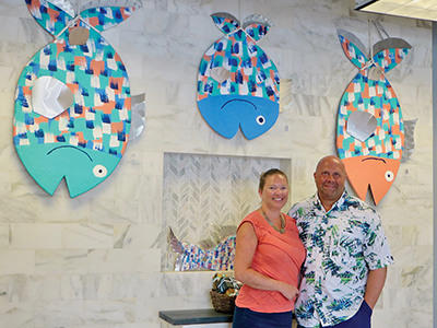 Kadie and Chris Signore in the showroom of their new business, Signore Coastal Art, in Old Town Bluffton. KATHLEEN WILLIAMS
