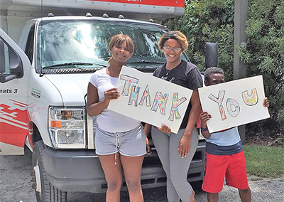 Former clients of Family Promise express their gratitude to staff, volunteers and donors who helped them achieve independence and find a new home of their own. COURTESY FAMILY PROMISE