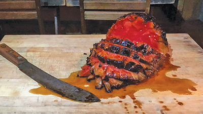 This smoked watermelon takes on the appearance of a baked ham, though a bit juicier.