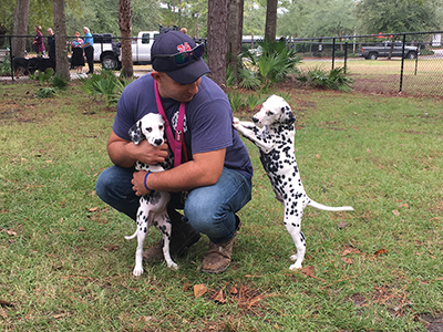 At just 10 weeks old, Haly (short for Halyard) and Nuri were the youngest pups to enjoy the newly opened Bluffton Dog Park at the ribbon cutting ceremony Nov. 7. They are pictured here with their human, Fred Weiman of Bluffton. The park is located at Osca