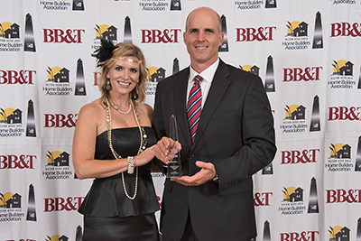 Ben Kennedy, pictured with his wife, Brittany Kennedy, was named Premier Builder of the Year at the Nov. 8 LightHouse Awards Gala of the Hilton Head Area Home Builders Association. COURTESY HHAHBA