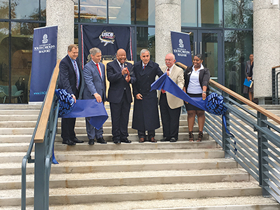 Dr. Al Panu, center, chancellor of USCB, reacts with glee after cutting the ribbon on the university's new $25 million Hilton Head Island campus Nov. 14. Joining Dr. Panu, from left, are Dr. Charlie Calvert, dean of the new campus; Town of Hilton Head Isl