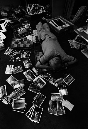 1974 minamata  japan %e2%80%93 w. eugene smith getting some sleep while editing his prints