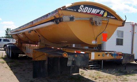 (2) Excavators, (2) 2005 Mack Semi Tractors, Payloader, Side Dump, Fuel Tanks