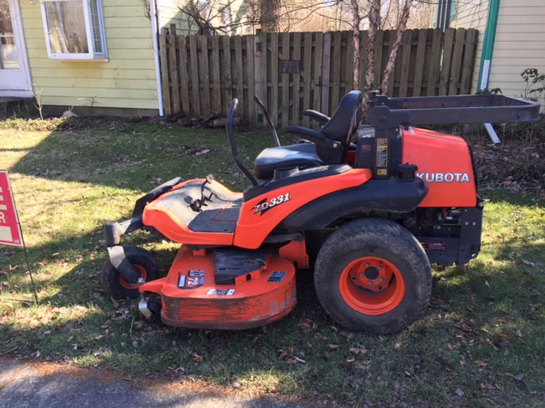 KUBOTA ZD331 Zero Turn Mower and Antique Display Case