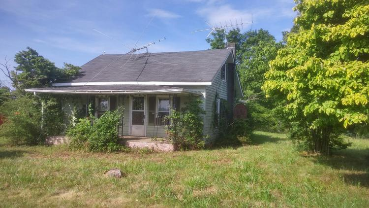 House with Buildings on 0.85 Acres in State Road, NC - Commissioner's Sale