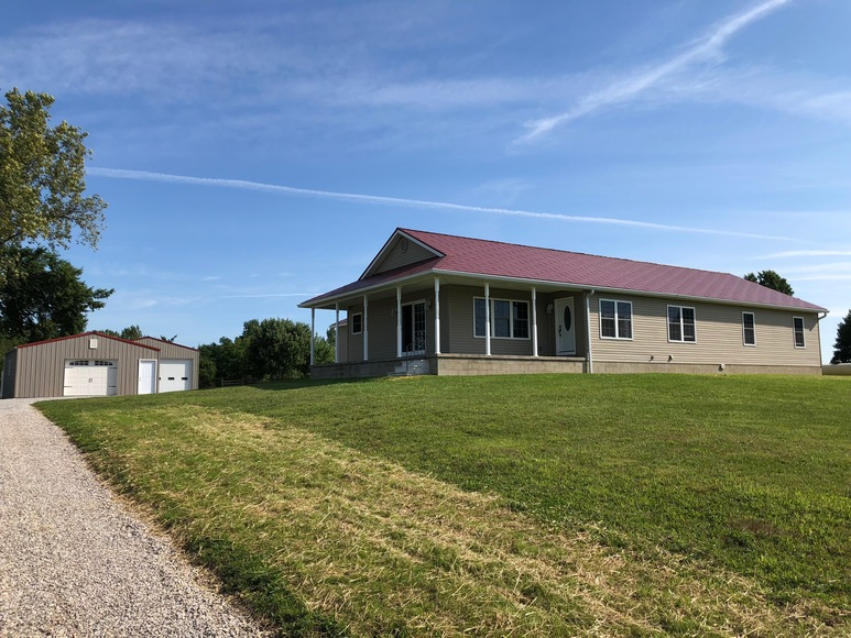 ABSOLUTE CUSTOM-BUILT RANCH HOME AND ACREAGE AUCTION