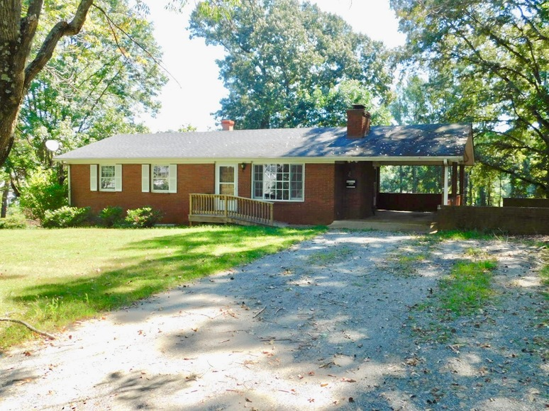 Featured Image for 1,400' +/- of Rt. 29 Frontage!!  16.24 +/- Acres Offered in 2 Parcels:  .88 +/- Acres w/5 BR/3 BA Home and 15.33 +/- Acres w/Mobile Home Park, Former Motel & Outbuildings.  Selling to the Highest Bidder Regardless of Price!!