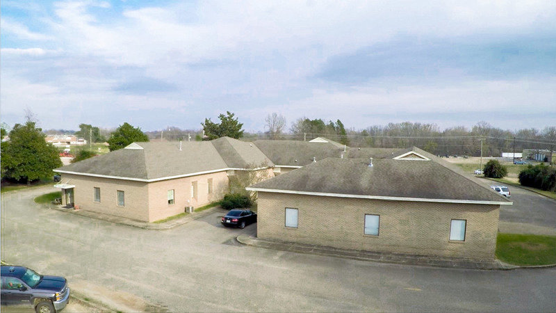 Income Producing Commercial Building! Long term renter on one side!