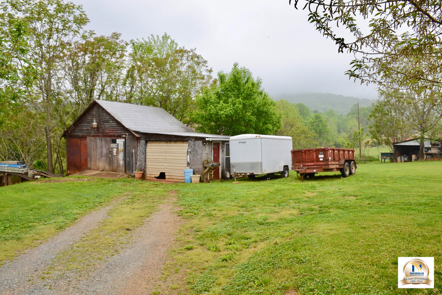 Featured Image for 3 BR Farm House, Outbuildings & Fenced Pastures on 28.75 +/- Acres w/Scenic Mountain Views in Greene County, VA