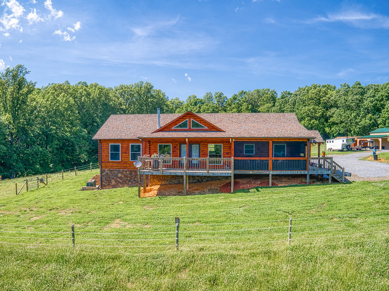 Like New 3 BR/3 BA Custom Built Log Home w/3 Barns on 23.4 +/- Acres Only Minutes From the Blue Ridge Parkway