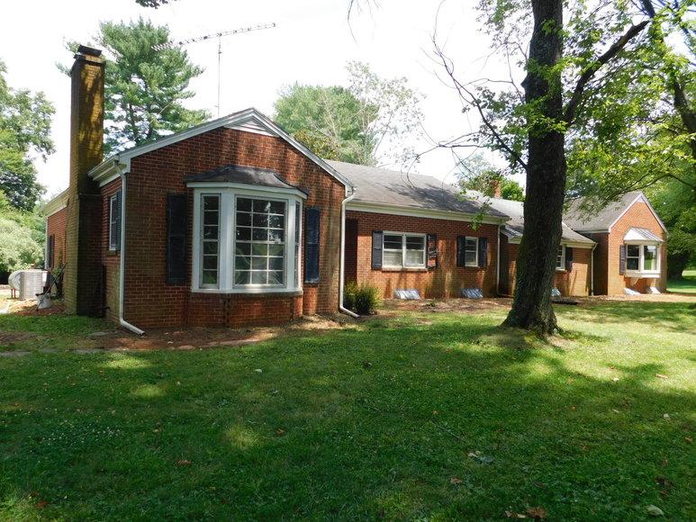 5 BR/3.5 BA Brick Home on 1.1 +/- Acres in the Town of Orange, VA
