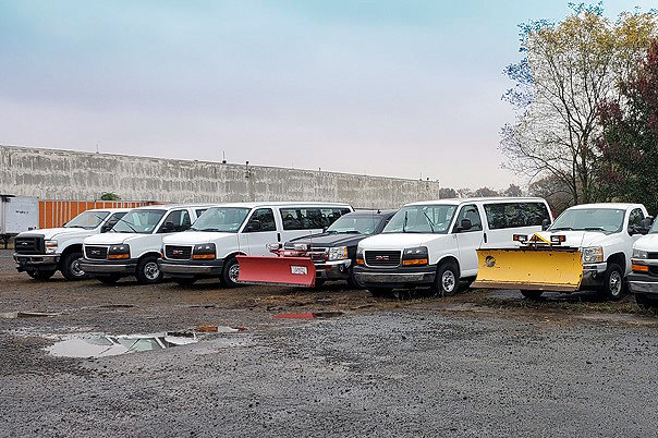 A Fleet of 65 Late Model Passenger Vans & Pick Up Trucks