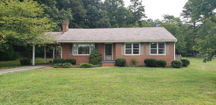 3BR 2BA Home on 3.88 Acres with Shop, Garage, and Storage Building