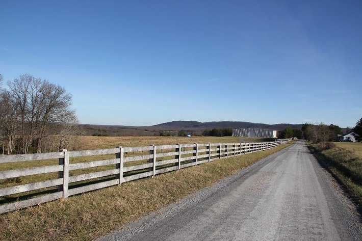 126+/- Acre Farm with Pond and 100' x 100' Shop