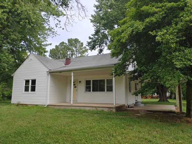 4 BR, 2 BA, UPDATED 2 STORY VINYL SIDED HOME W/ COVERED CARPORT ON .54+/- ACRE LOT