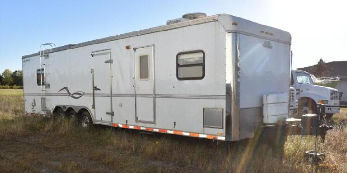 (5) Storage Trailers, 1999 International 4700 Straight Truck, 2002 CampMaster Toy Hauler