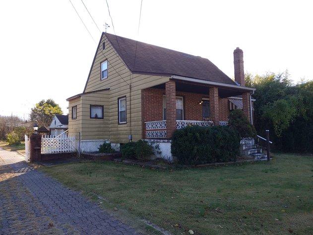 2 STORY CAPE COD HOME 3 BEDROOMS, 1 ½ BATHS,  DETACHED 3 VEHICLE GARAGE & CARPORT