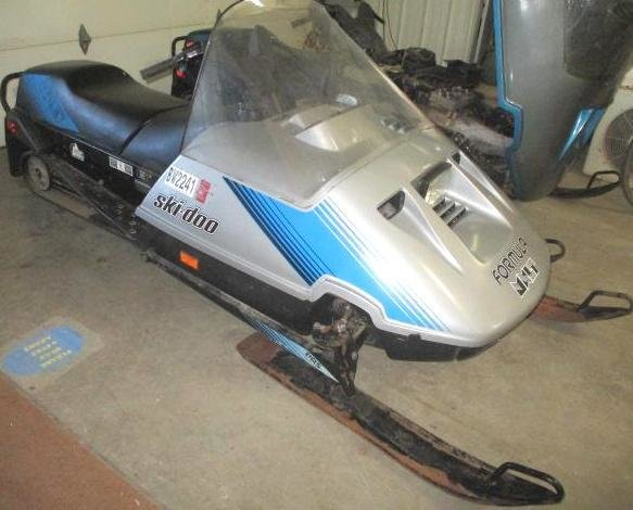BUHL ONLINE AUCTIONS: BOMBARDIER SNOWMOBILE & DOLLY ONLINE AUCTION