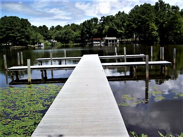 Featured Image for 3+ Acre Wooded Corner Lake Gaston Building Lot w/Deeded Boat Slip--ONLINE ONLY BIDDING!!