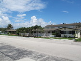 """On-Site Real Estate Auction of the""""Oasis by the Sea"""" Apartment Building"""