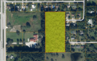 For Sale ONLY at ABSOLUTE AUCTION this 5 AC Multi-family Parcel